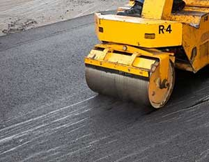 rolling and placing your newly placed driveway material