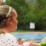 Woman looking at pool considering an inground pool removal service