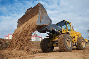 bulldozer laying fill dirt in a construction site
