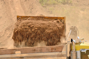 fill dirt being loaded onto a truck