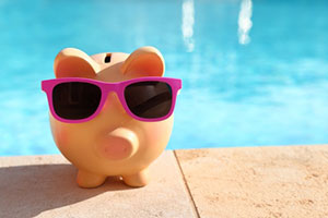 Image of piggy bank depicting cost of pool and consideration of an inground pool removal