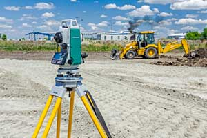 Image of surveying land during a site inspection before a fill dirt delivery