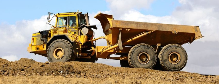 a dump truck conducting a Chantilly, VA fill dirt delivery at a construction site