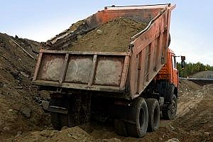 a truckload carrying many cubic yards of dirt