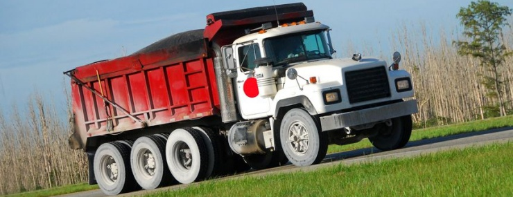 an Ashburn, VA fill dirt delivery truck driving on the highway to a site