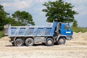 blue dump truck in Vienna, VA hauling a load of fill dirt