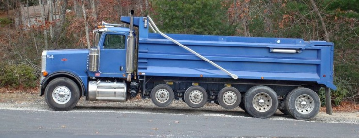blue dump truck parked on the road after a Gainesville, VA fill dirt delivery