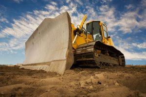 bulldozer at a Manassas, VA construction site scooping up fill dirt