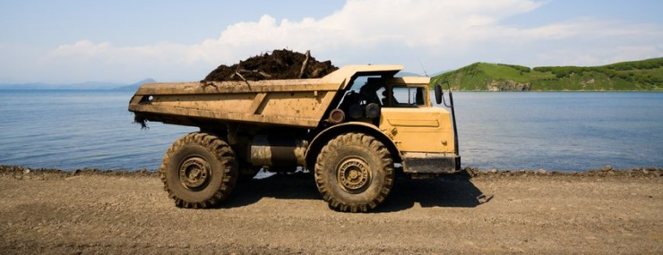 dump truck on the lake in a Sterling, VA fill dirt delivery