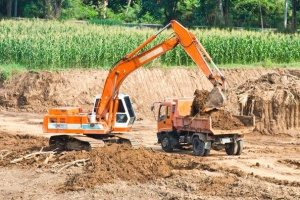 excavator loading a dump truck at a Sterling, VA construction site
