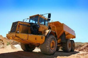 tall orange dump truck loading up at a quarry in Manassas, VA