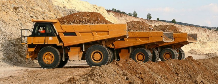 three small dump trucks loading up for a big Arlington, VA fill dirt delivery