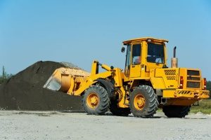 Potomac, MD construction loader taking clean fill dirt to a dump truck to be delivered
