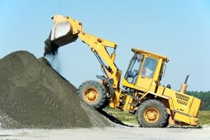 bulldozer in Bowie, MD working with dirt in a pile from a free fill dirt delivery