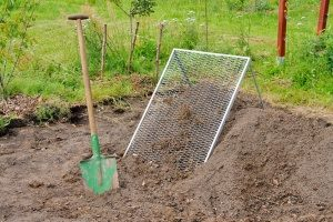 dirt with a screen and shovel in a backyard where a fill dirt contractor transported dirt to