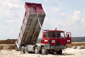dump truck in Bowie, MD on a fill dirt delivery run to a commercial building project site