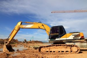 excavator doing digging and earthmoving after a Bowie, MD fill dirt delivery via dump truck