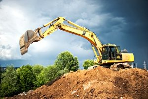 excavator doing earth moving at an Annapolis, MD fill dirt construction site for a new project