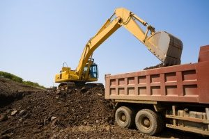 excavator loading up a dump truck to make another Laurel, MD fill dirt delivery