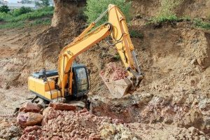 excavator working with fill dirt to put into ta dump truck so that it can make a fill dirt delivery in the Rockville, MD area