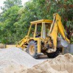 fill dirt contractor in Fairfax, VA operating a miniature excavator