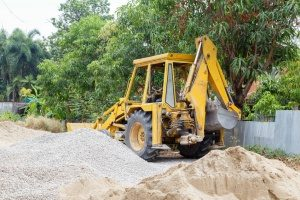 fill dirt contractor in Fairfax, VA operating a miniature excavator