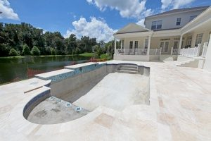 house in Fairfax, VA next to a small lake undergoing an inground swimming pool removal