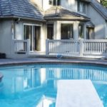 pool with a diving board in Fairfax, VA that needs inground pool removal services