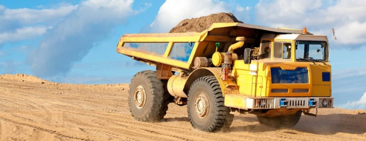 yellow dump truck carrying a masssive load of dirt for a free Hagerstown, MD fill dirt delivery to a sports complex