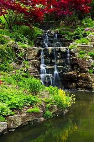 Rock waterfall made in backyard using fill dirt