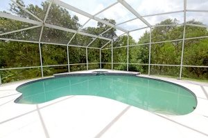 an above ground pool that was transformed to look exactly like an inground pool thanks to good quality Maryland free dirt