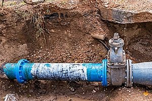 blue PVC pipe that can drain better and be better protected while buried with adequate amounts of fill dirt