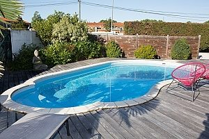 private pool fenced off using retaining walls where the foundation for both the pool and walls compose of fill dirt