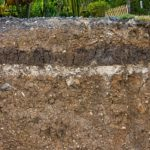 Different layers and types of dirt including Virginia fill dirt and topsoil