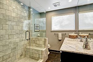 a brand new Fairfax bathroom remodeling projct that includes a walk-in brick shower and a modern sink