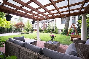 a beautiful deck that has been converted into a sunroom since the pool in the homeowners backyard was removed and there is more yard space