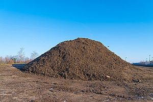 a large heap of fill dirt which will be removed from a construction site through a dirt removal contractor