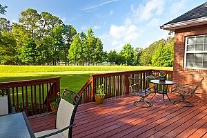 a wooden deck in a homeowners backyard that was installed after having received Fairfax, VA pool removal services