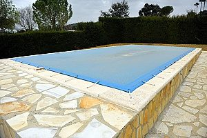 covered pool for the winter since the homeowner did not want to receive a pool removal service during the fall