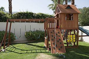 a playset that was recenty built by a homeowner in his backyard with fill dirt as the base