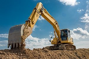 a contractor using an excavator and working on a commercial construction site while using Virginia fill dirt