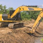 an excavator working with clean fill dirt to dig out a pipeline for a home in Fairfax, VA