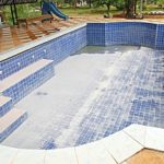 a swimming pool that has been drained before a spring pool removal