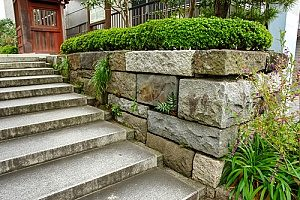 front yard retaining walls next to the front walkway of a home