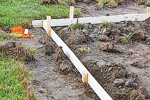 stakes in the ground to mark where front yard retaining walls will be marked