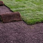 layers of sod removed from a backyard where an artificial turf putting green will be placed