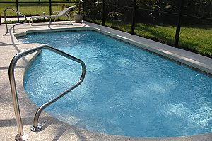 a backyard pool that needs pool removal services