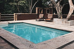 a backyard pool that will receive summer pool removal
