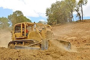 a bulldozer working with different types of fill dirt at a construction site