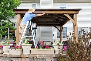 a man installing a gazebo in his backyard after pool removal services